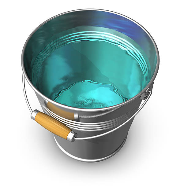 Metal bucket full of clear water stock photo