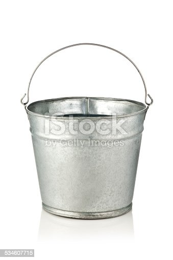 Old metal bucket isolated on reflective white background