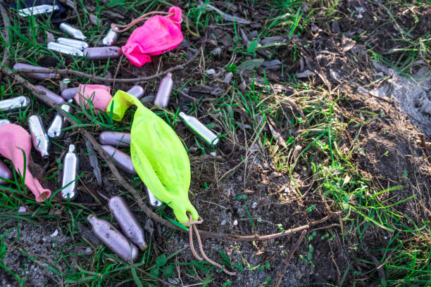 metal bulbs laughing gas and balloons in grass field partydrugs with nitrous oxide nitrous oxide stock pictures, royalty-free photos & images