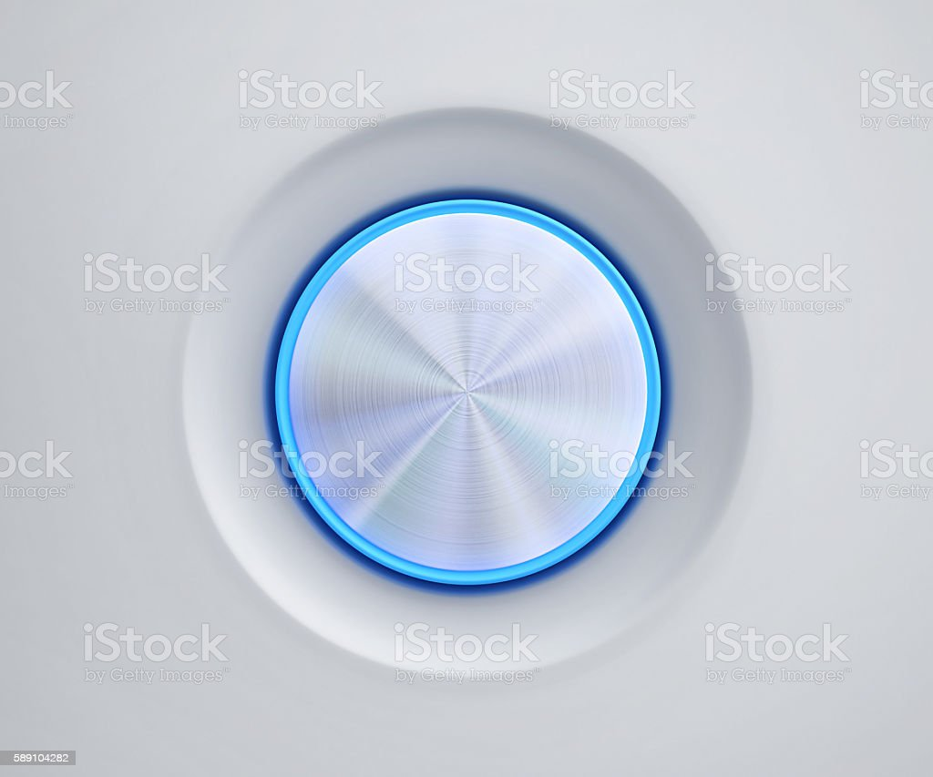 Metal button with blue glow stock photo