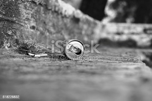 istock Metal can and cigarette in the park. Garbage. Trash 518226832