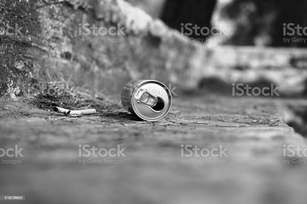 Metal can and cigarette in the park. Garbage. Trash stock photo