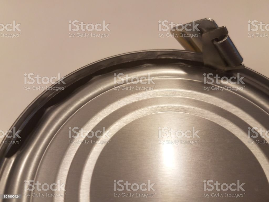 metal can with military style can opener stock photo