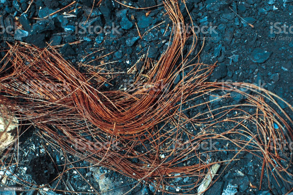 Metal carcass of the burnt automobile rubber tire stock photo