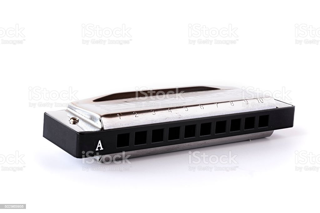 Metal case harmonica isolated on white stock photo