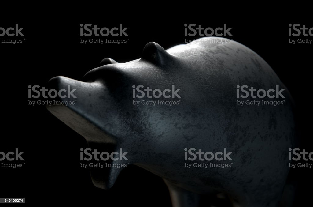 Metal casting depicting a stylized bear in dramatic light representing financial market trends stock photo