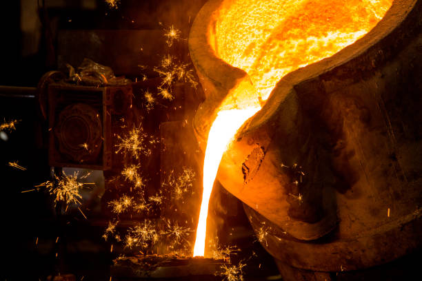 metal casting process with red high temperature fire in metal part factory metal casting process with red high temperature fire in metal part factory metalwork stock pictures, royalty-free photos & images