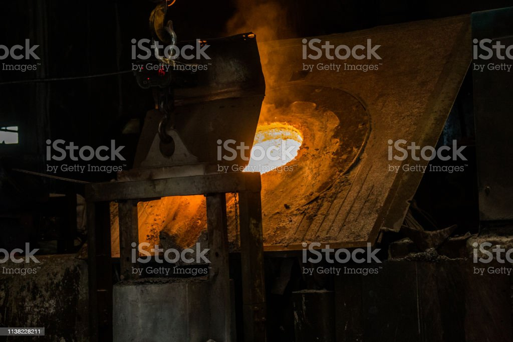 metal casting process with red high temperature fire in metal part...