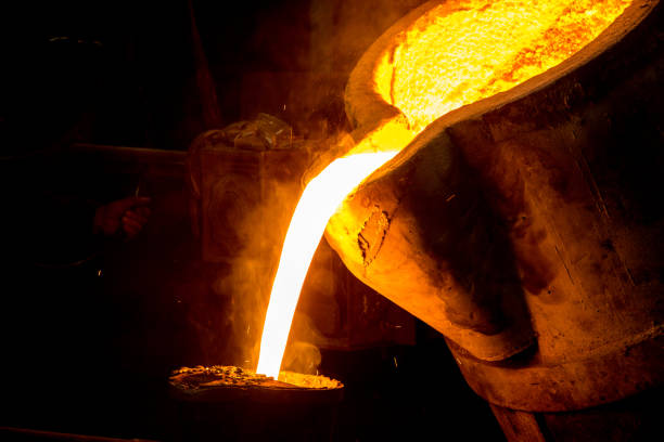 metal casting process with red high temperature fire in metal part factory stock photo