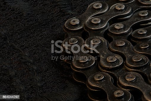 924754302istockphoto Metal Chain round up circle on black fabric, close up 864044292