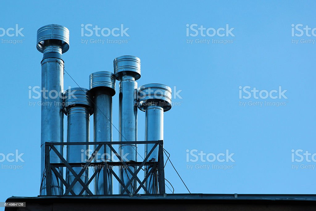 Metal chimneys on a roof stock photo