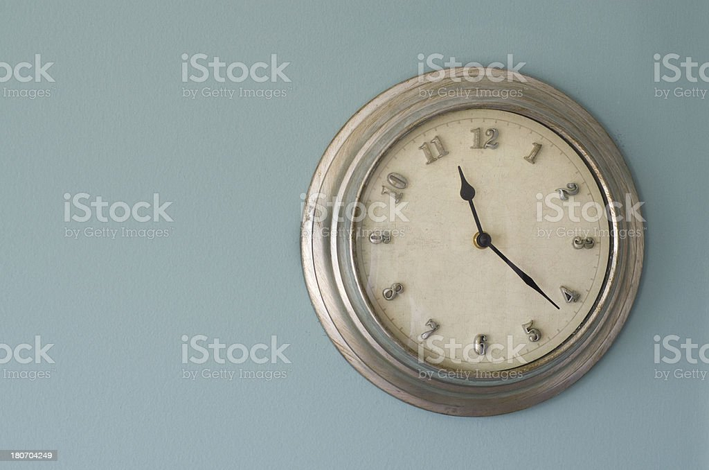 metal clock on a wall stock photo
