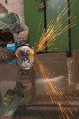 One way of handling metallov.Puchok sparks of cutting machine