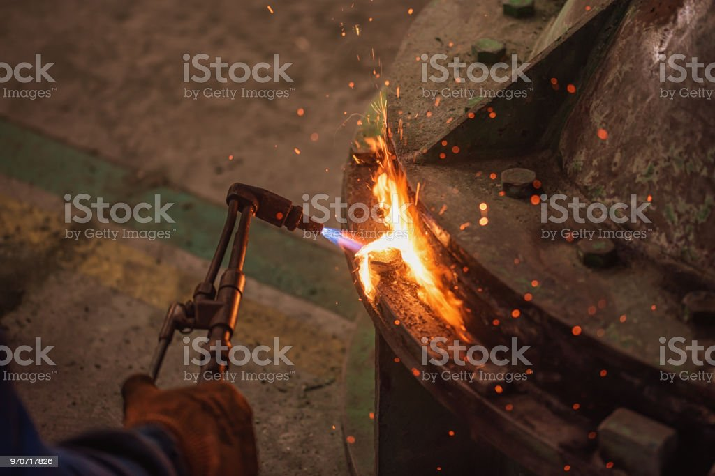 Metal cutting with acetylene and oxygen gas torch. Soft focus due to high ISO and shallow Depth Of Field. stock photo