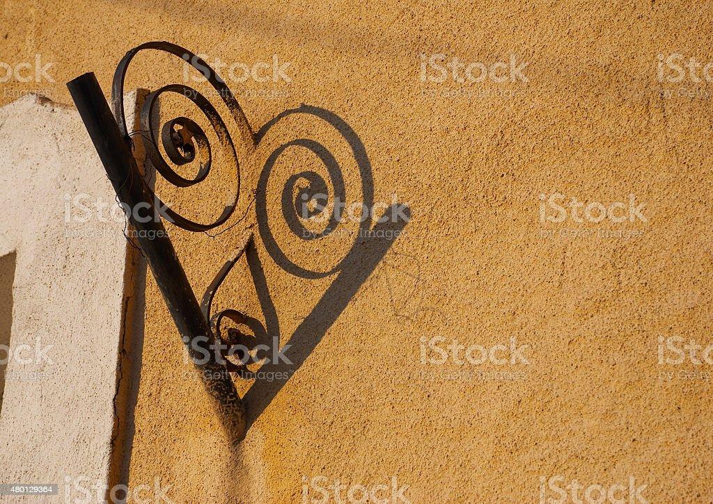Metal decoration on yellow wall stock photo