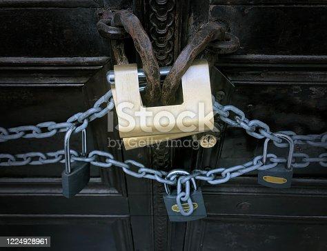 Metal door and padlocks.