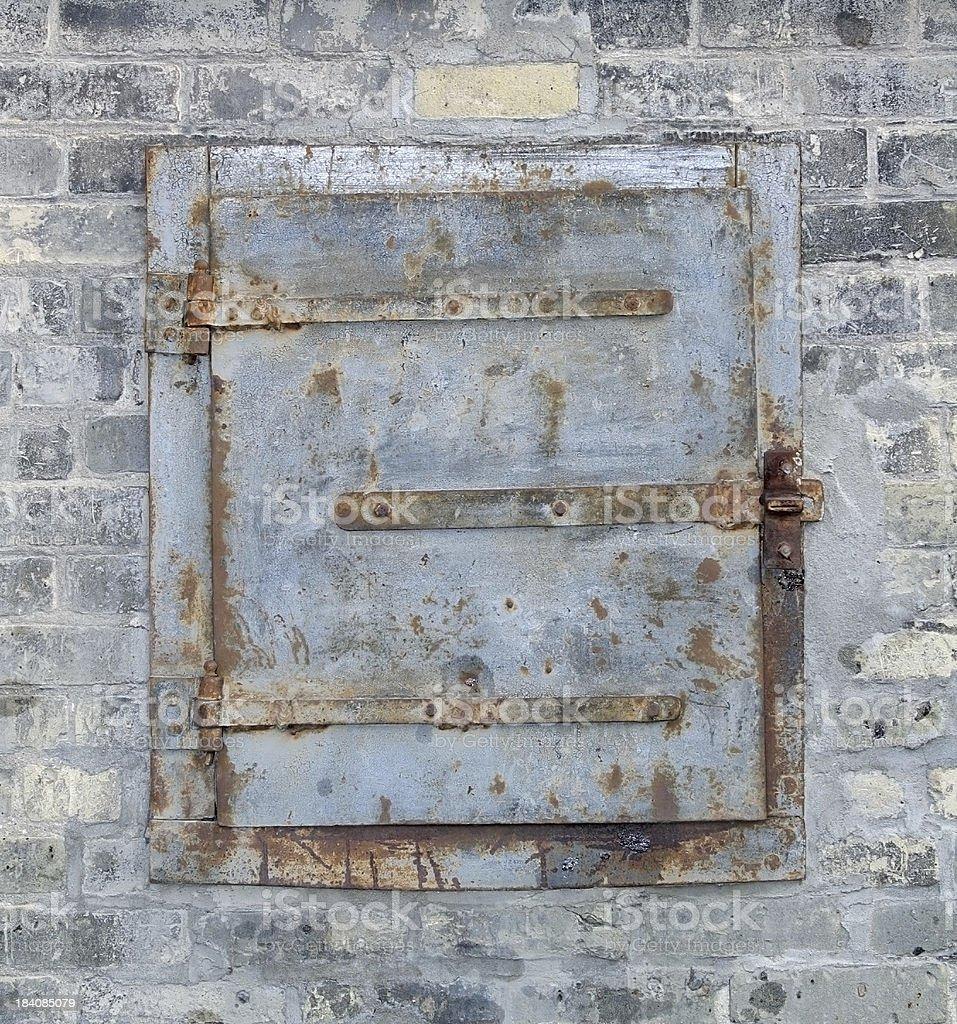 Metal Door brick wall. stock photo