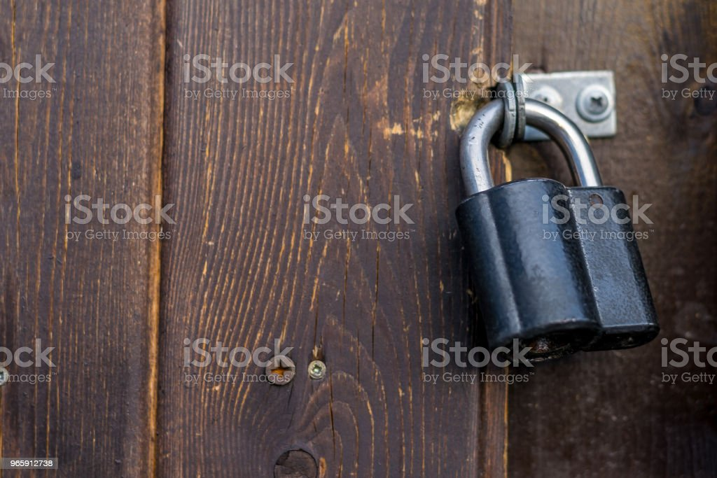 metal door lock on a brown background dark wooden door - Royalty-free Antique Stock Photo
