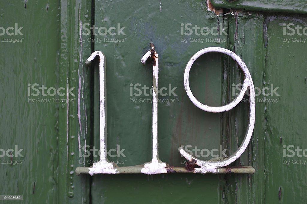 Metal door number 119 stock photo
