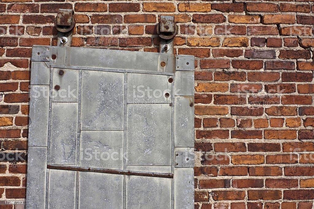 Metal Door On Brick Wall stock photo