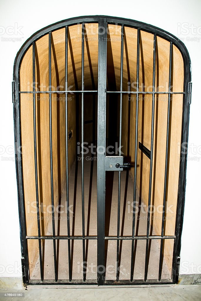 metal door with bars in a prison stock photo