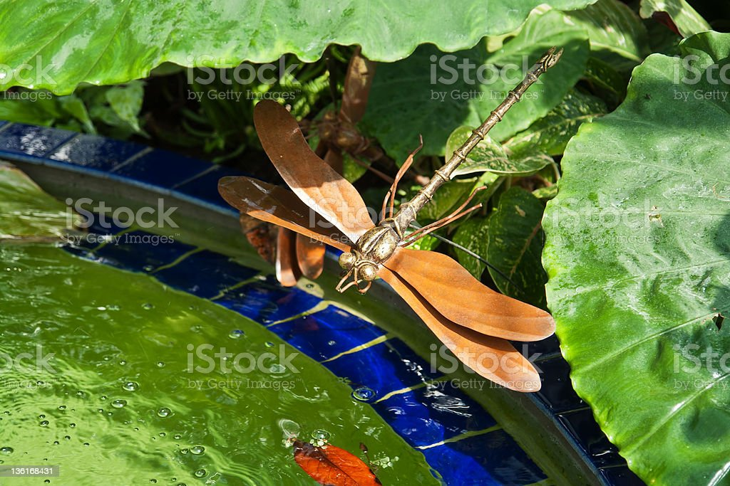 Metal dragonfly statue stock photo