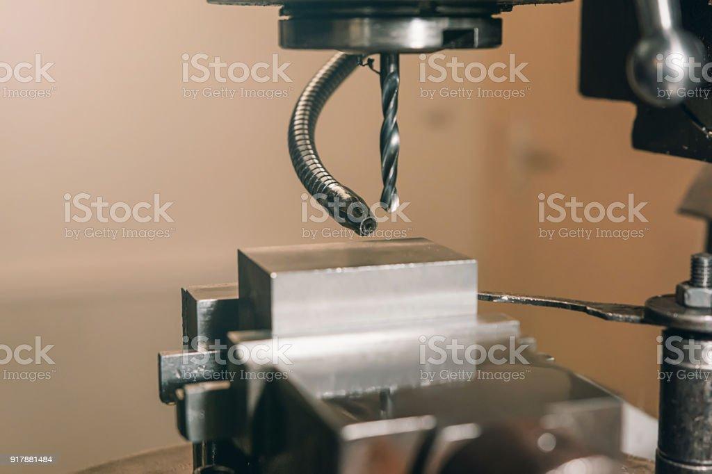 Metal drill Close-up. Metal workshop. stock photo