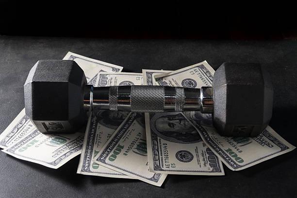 metal dumbbell on money. - paper mass bildbanksfoton och bilder