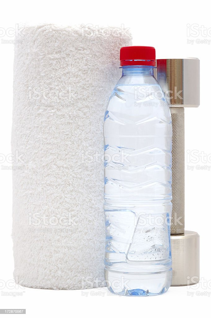 Metal dumbbell with bottle of water and towel royalty-free stock photo