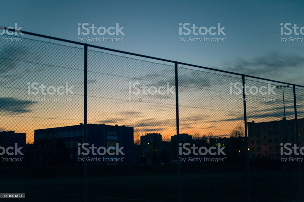 Metal fence against the sky stock photo