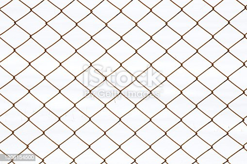 istock Metal fence background, real fence close-up and texture on the white sky background 1306154500