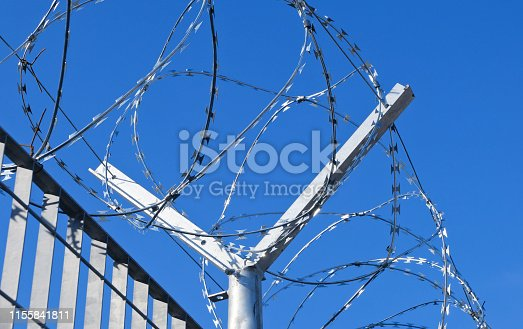 Metal fence, Barbed wire at the border