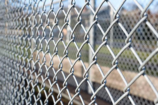 metal fence cage closeup stock photo