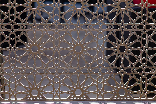 istock Metal fence, close up. Beautiful decorative cast iron wrought fence with artistic forging 1035442770
