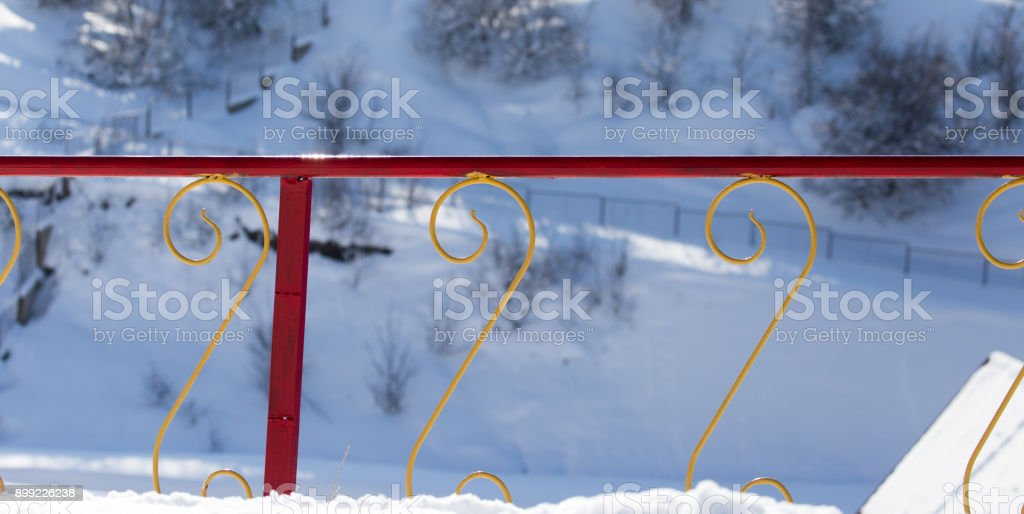 metal fence outdoors in winter stock photo