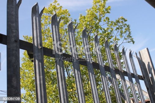 Metal Fence with sharp spikes on top for security