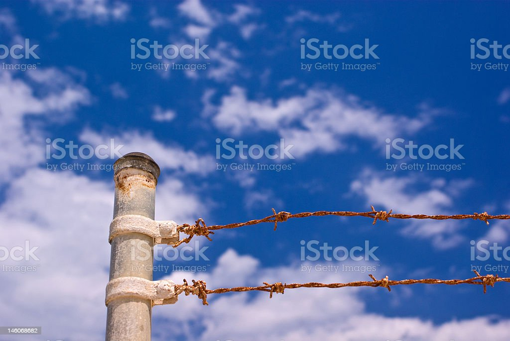 Metal Fence Post and Barbed Wire stock photo