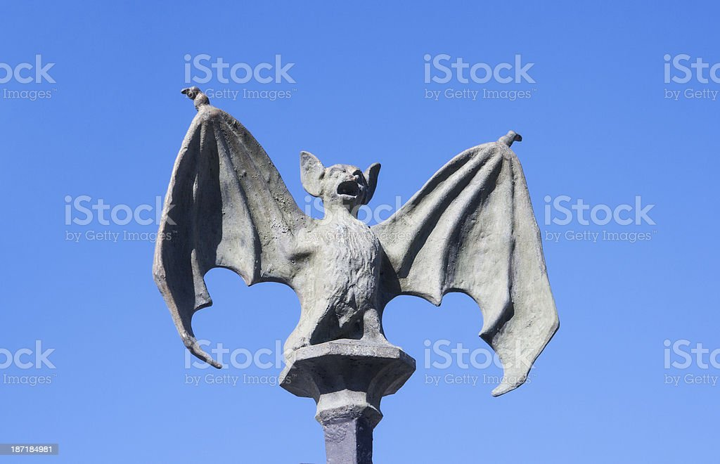 Metal Fence Post Decoration of Menacing Bat with Wings Outstretched stock photo