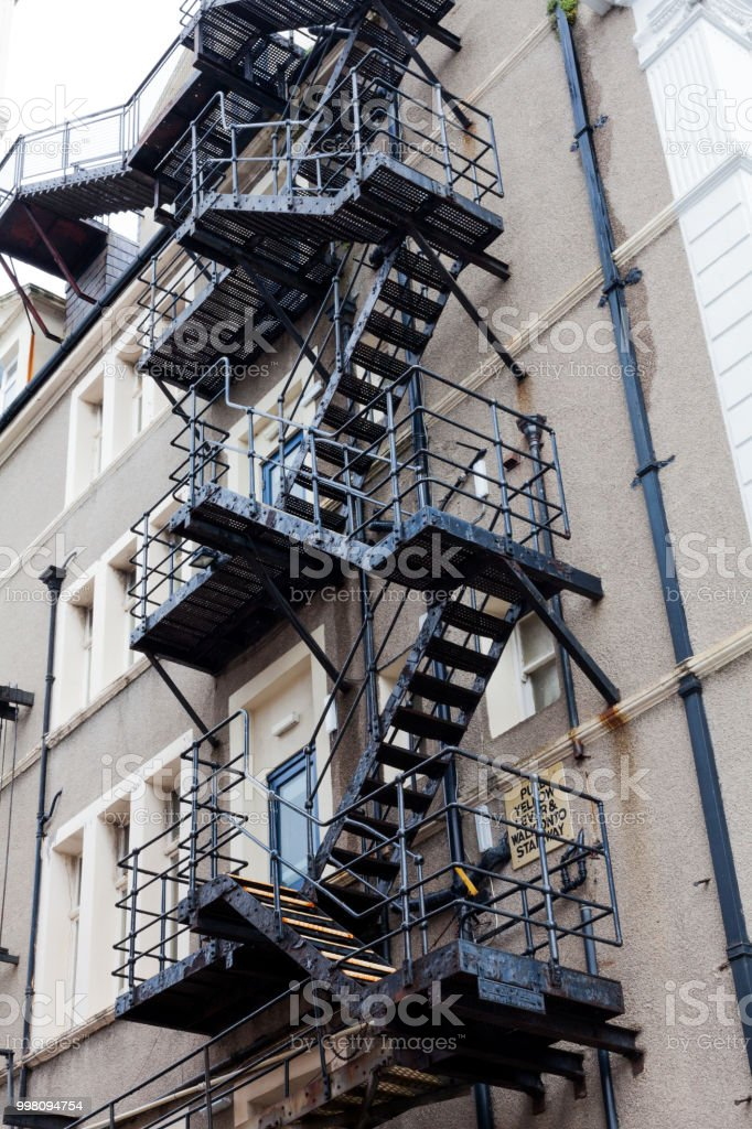 Metal Fire Escape Stairs. Fire Escape Stairs Behind A Building. Stairs On  The Back