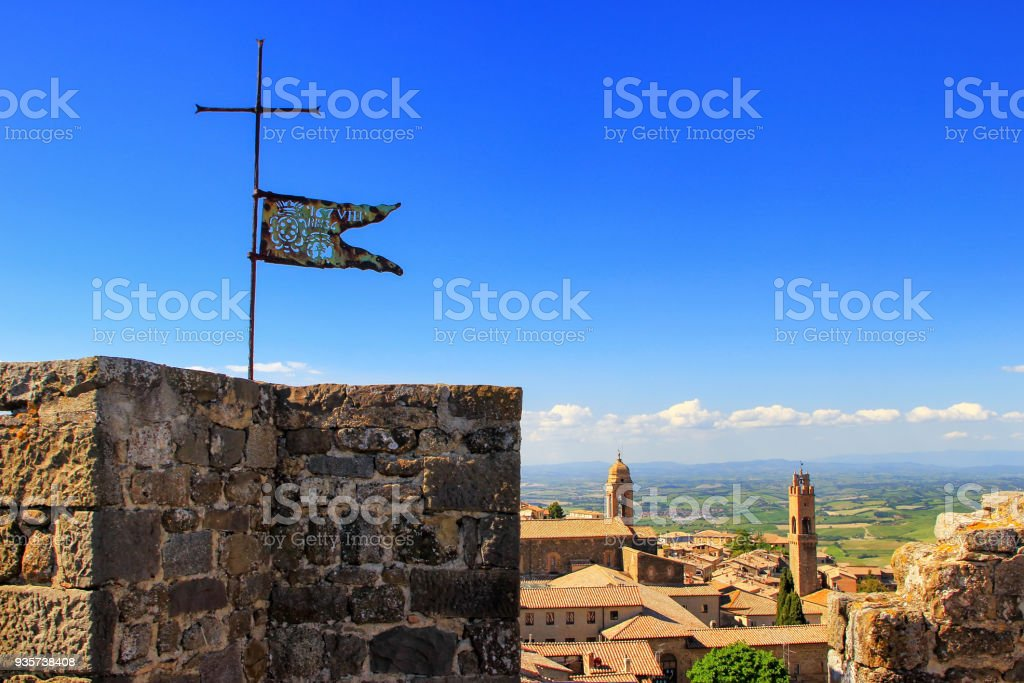 Metal flag on the top of Montalcino Fortress in Tuscany stock photo
