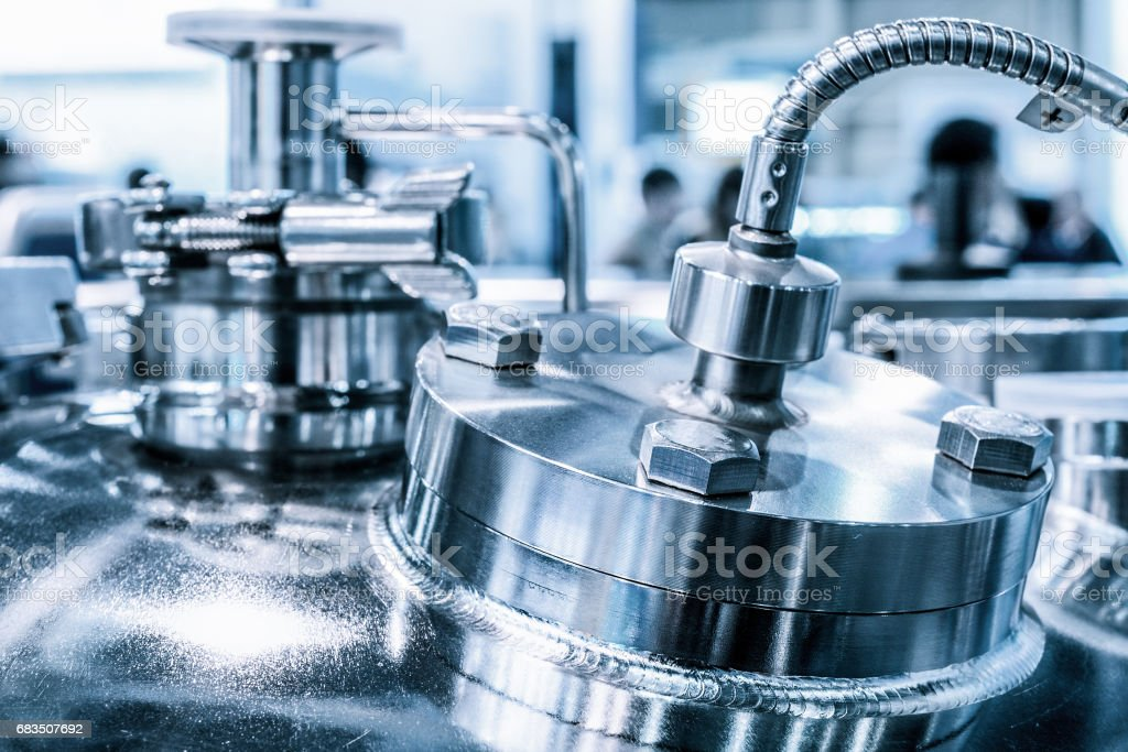 Metal flanges with flexible nipples, chemical reactor body, selective focus stock photo