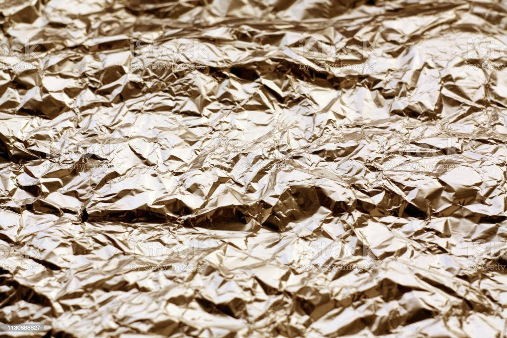 Metal foil texture in brown tone. Abstract background and texture for...
