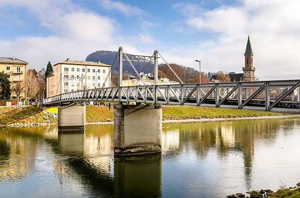 metal foobridge over a river and reflection in water - eisenstadt austria stock-fotos und bilder