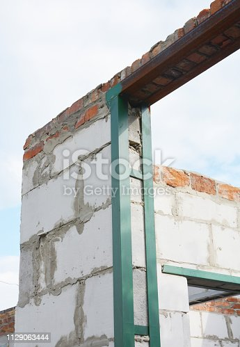 Metal frame for earthquake building protection.Earthquake-resistant structures with metal frames on entrance and window lintels.