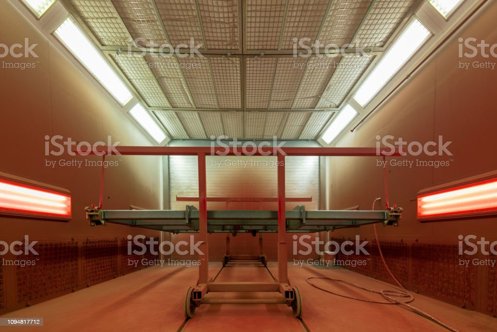 Metal frames in the spray booth. Industrial painting of metal products stock photo