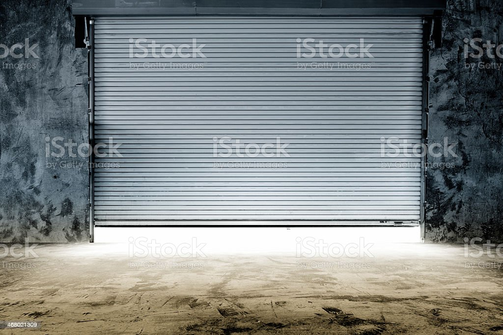 Metal Garage Door Opening For The Morningu0027s Work Royalty Free Stock Photo