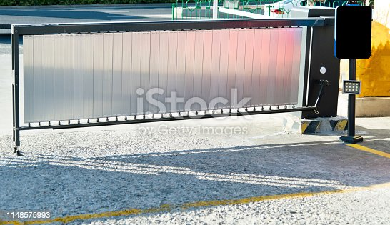 858738110 istock photo Metal gate of the parking lot 1148575993