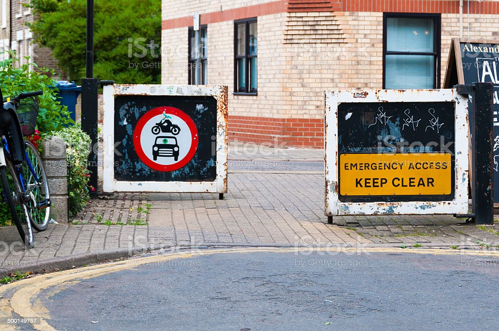 Warning sign on a metal door for motorists in Cambridge, UK