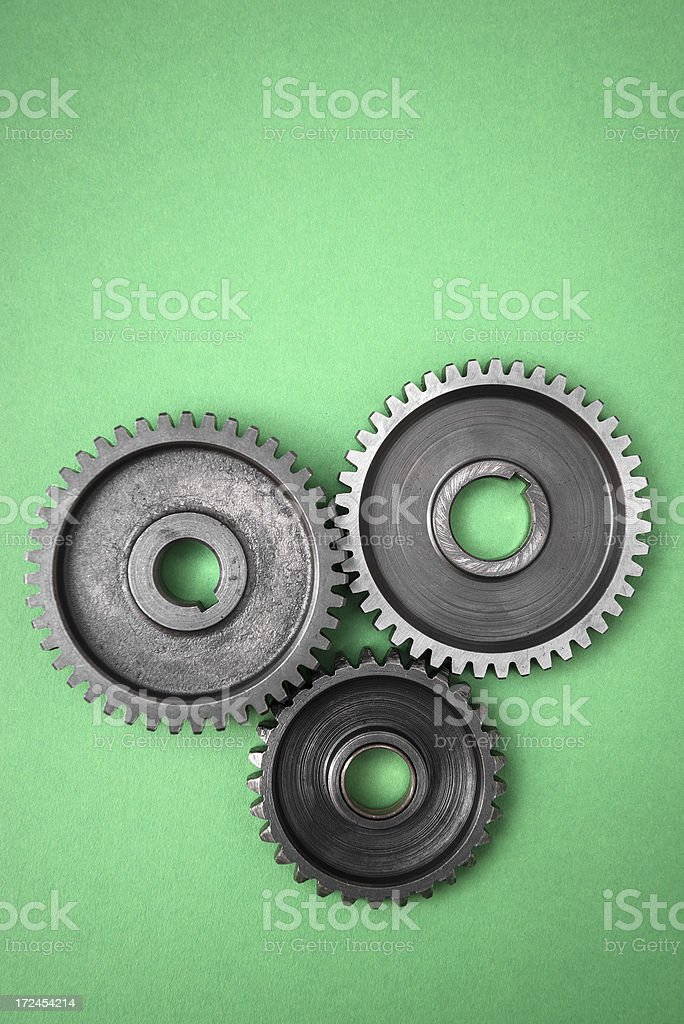 Metal Gear of machine part on green stock photo
