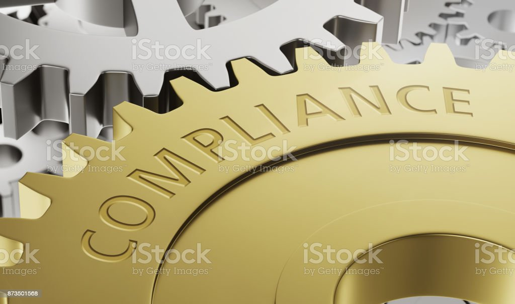 Metal gear wheels with the engraving Compliance - 3d render stock photo